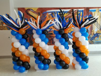 Balloon columns with wacky toppers