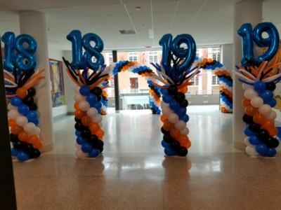 Balloon columns with numbers and wacky toppers